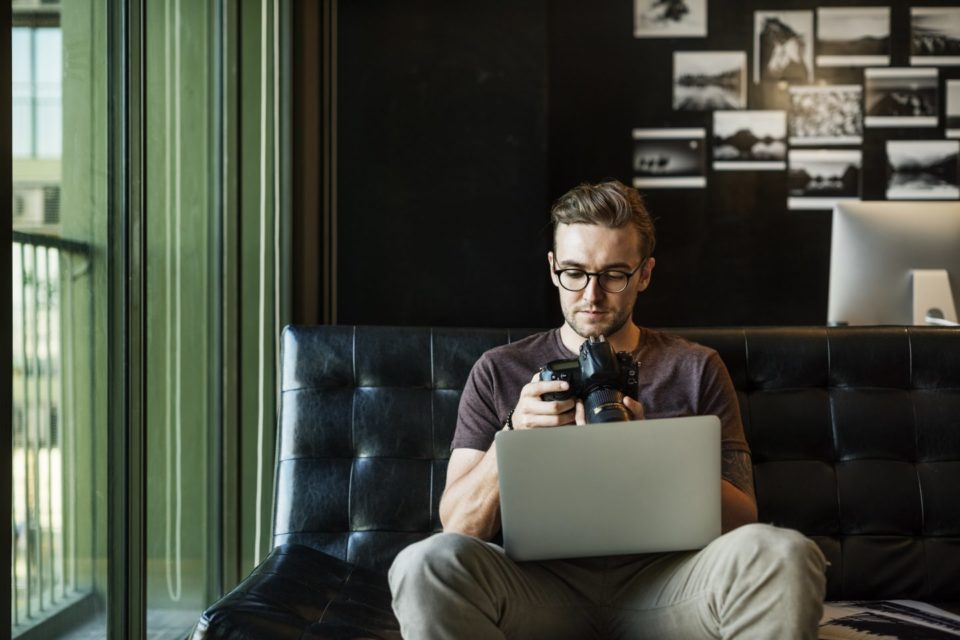 man busy photographer editing home office concept PJNFNZK